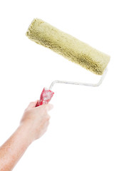 Hand holding paint roller