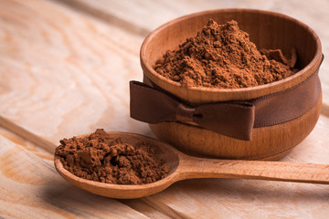flavored cocoa powder in wooden bowl