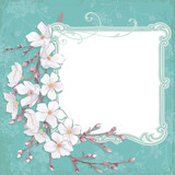 Frame composition with blossoming cherry branch
