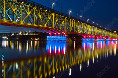 Illuminated bridge and city - 61174367