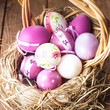 Easter purple eggs in basket