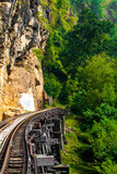 Dead railway beside cliff, along Kwai river in Thailand