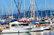 Yachts and boats anchored at a marina.  Sailing Boats
