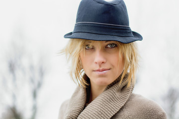 Pretty blonde girl with fedora hat