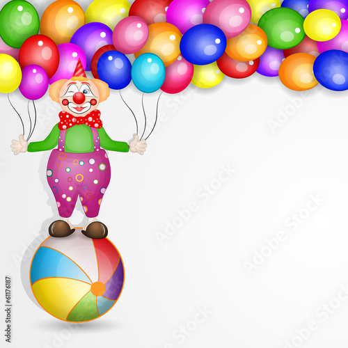 Clown on the ball with balloons