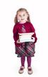 Little girl holding books preparing to go back to school -