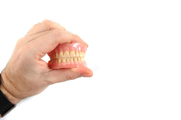 teeth prosthesis in human hand