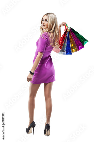 Fashion Girl Portrait.  Woman with Shopping Bags. Shopper. Sales