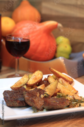 beef steaks with potatoes and wine