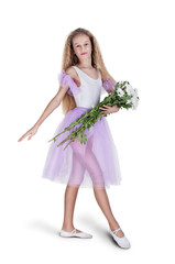 Happy little dancer girl posing in white dress ballerina