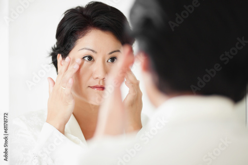 applying facial treatment or cream