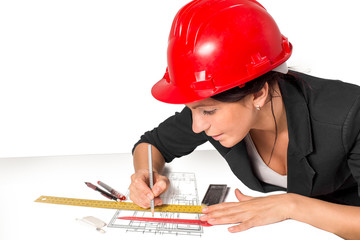 Young woman architect working on blueprint for a new home.