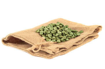 Empty coffee bag made from burlap. With green coffee beans