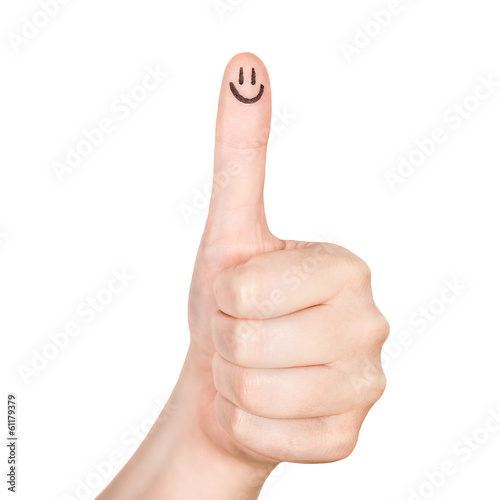 Female hand shows thumbs up with smile face on the finger .