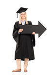 Smiling female in graduation gown holding a big black arrow