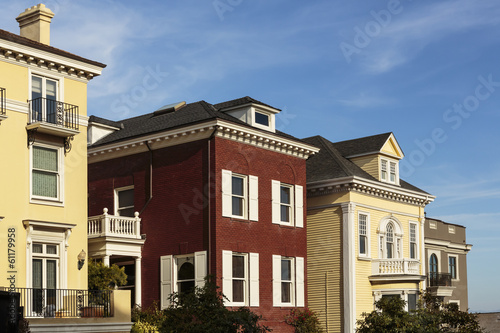 A row of upscale houses against blue sky