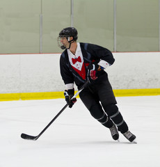 Man playing ice hockey