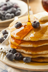 Homemade Buttermilk Pancakes with Blueberries and Syrup