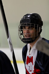 Hockey player watches the game from the bench