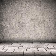 Gray concrete wall and brick floor interior