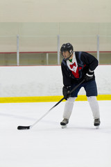 Hockey player ready for the drop of the puck