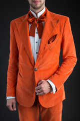 Orange suit orange bow tie