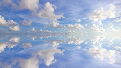 Reflection of beautiful blue sky with clouds
