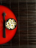 Chopsticks with flowers on Japanese red tray