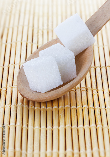 refining sugar cube in spoon