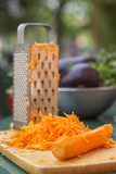 Carrot and grated carrot on a cutting board