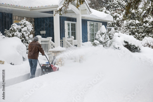 Man using snowblower in deep snow