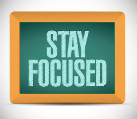 stay focused message on a chalkboard.