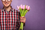 man clothing hipster holding a bouquet of flowers