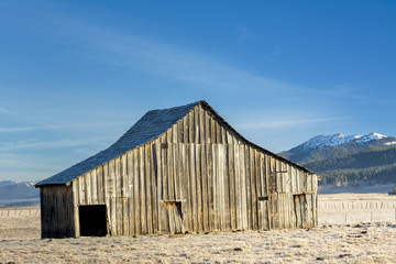 Beautiful barn with Idaho mountains in winter