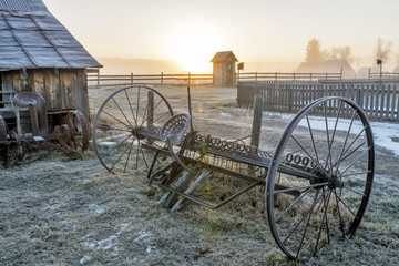 Sunrise on a country farm and equipment