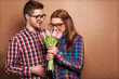 Portrait of young couple in love with flowers tulips