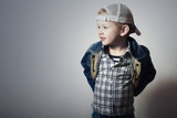 Child. Funny Little Boy in Jeans.Trucker cap.plaid shirt.Denim
