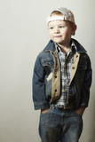 Posing Child. Funny Little Boy in Jeans.Trucker cap.Denim Wear