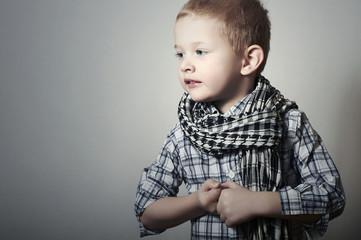 Child. funny little boy in scarf. Fashion Children.plaid shirt