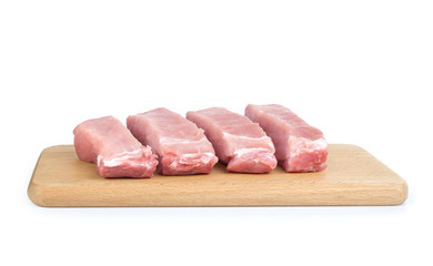 Many fresh pork chops or cutlets with parsley