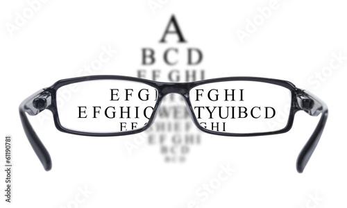 Sight test seen through eye glasses - 61190781