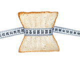 Piece of bread grasped by measuring tape poster