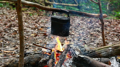 Pot camping on fire in a forest