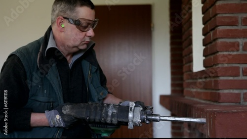 man with hammer drill