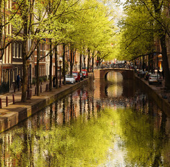 Amsterdam city with green canal in Holland