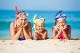 Fototapety three happy children on beach...