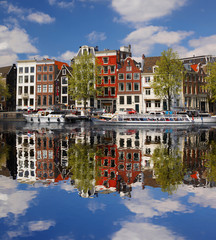 Amsterdam city with boat on canal in Holland