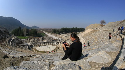 tourist use digital tablet in amphitheather of ancient Ephesus