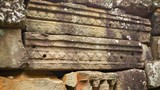 Stone blocks from the ancient wall of the temple. Angkor, Cambod