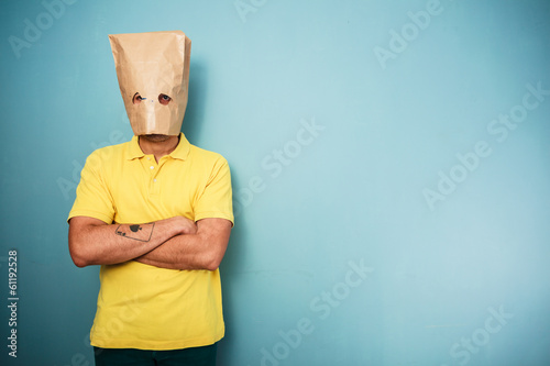 Young man with bag over his head